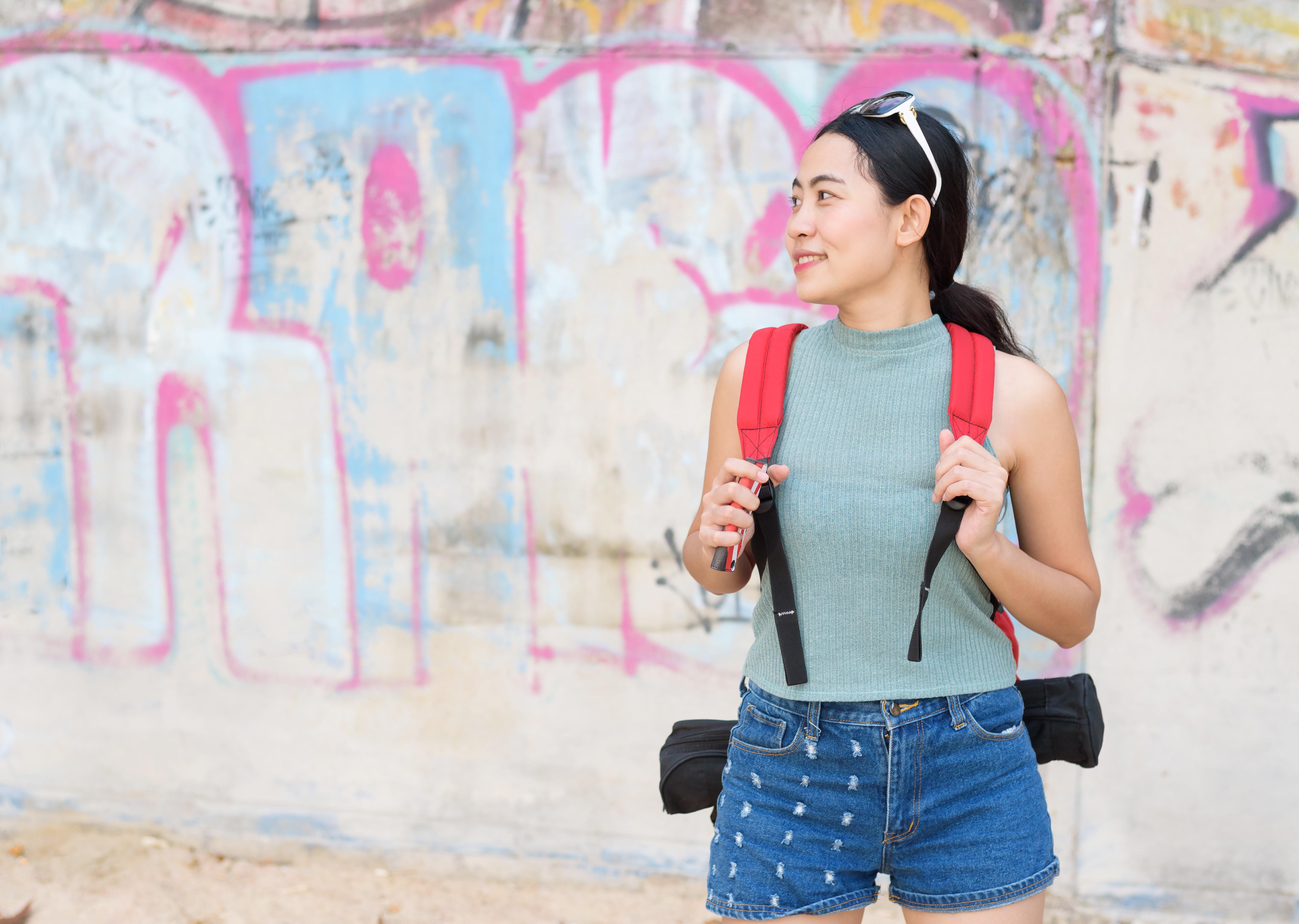 Asian woman solo travels summer lifestyle in Krabi beach, Thailand.